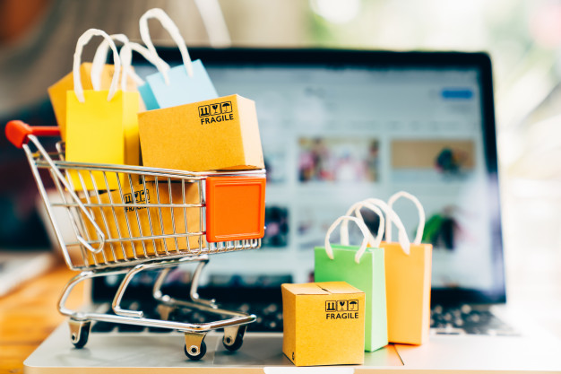 product-package-boxes-shopping-bag-cart-with-laptop-online-shopping-delivery-concept_38716-138